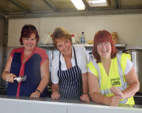 Our Lovely Lions Ladies serving food & drinks