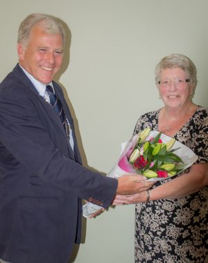 Roger presenting Eileen with flowers