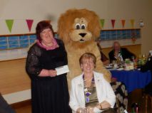 The apperance of Rufus the Lion with District Governor Marianne Warren and Lion Sue