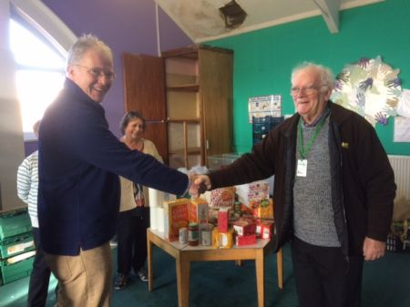 President Roger shaking hands with Alun of the Food Bank